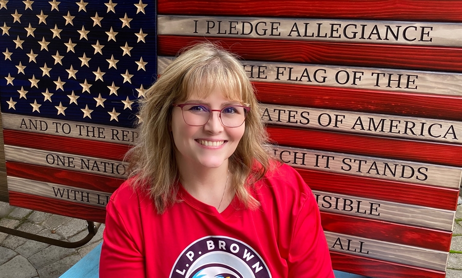 Photo of Mrs. Neely with a flag background